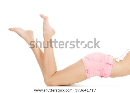 Slim woman legs in shorts. - stock photo