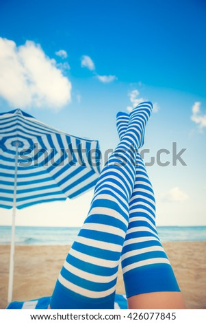 Slim woman legs on a beach. Summer vacation and travel concept - stock photo