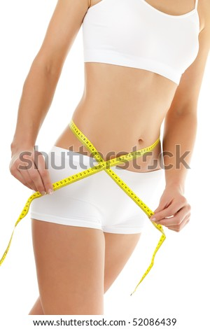 Slim woman measuring her body isolated on white background - stock photo
