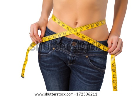 Slim woman measuring her waist - stock photo
