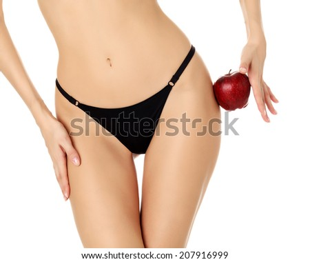 Slim woman with apple, white background, copyspace - stock photo
