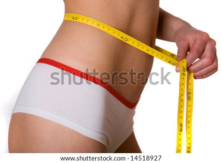 slim woman with measuring tape on belly - stock photo