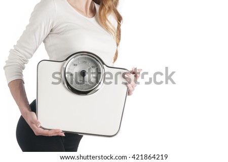 Slim woman with scales on white background - stock photo
