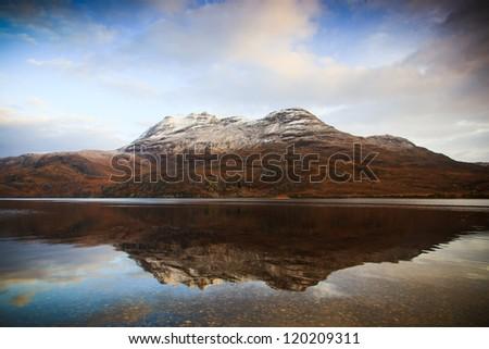 Slioch Mountain Reflected in Loch Maree - stock photo