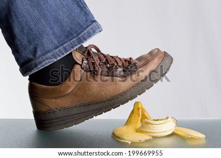 slip on a banana peel - stock photo