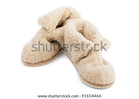 Slippers of wool on a white background - stock photo
