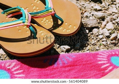 Slippers on beach.