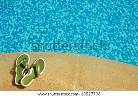 Slippers on edge of pool