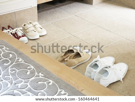 Slippers on the floor of hotel room - stock photo