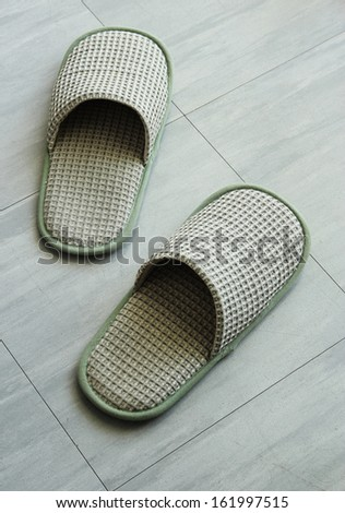 Slippers on the floor tile - stock photo