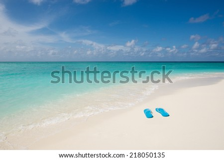 Slippers on tropical beach, Maldives - stock photo
