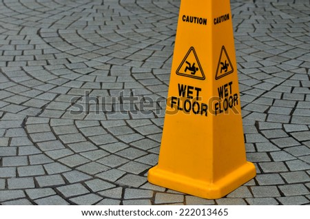 Slippery floor surface warning sign and symbol in building, hall, office, hotel , restaurant, restroom. Concept photo danger. - stock photo