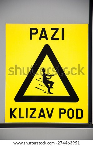 Slippery when wet sign. - stock photo
