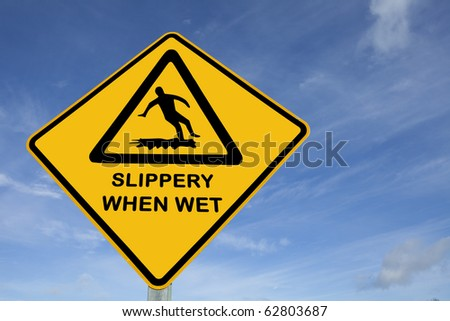 Slippery when wet sign - stock photo