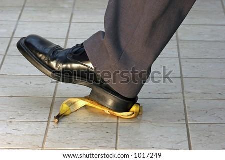 slipping on a banana peel - stock photo
