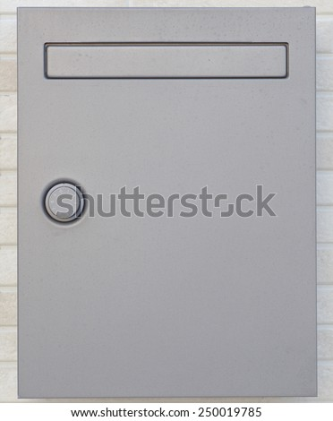 Sliver letterbox or mailbox and modern concrete wall at house - stock photo