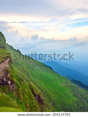 slope of green alpine  meadow in Indian Himalaya - stock photo