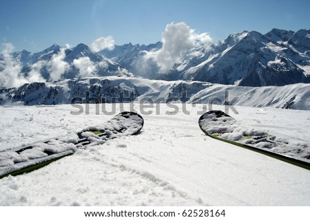 Slope view.Skis and mountain panorama.Alps - stock photo