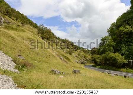 slopes and road at Cheddar gorge, Somerset landscape of the famous touristic narrow valley with the road  that bends among the cliffs  - stock photo