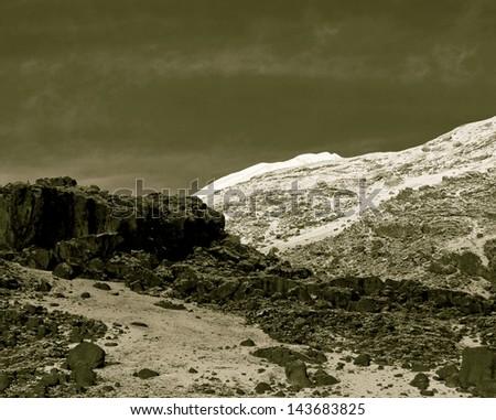 Slopes of Kilimanjaro (5.895 m) - Tanzania (stylized retro) - stock photo