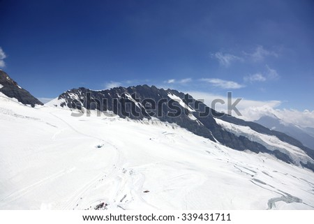 Slopes of monch and Trugberg mountains in Jungfrau region - stock photo