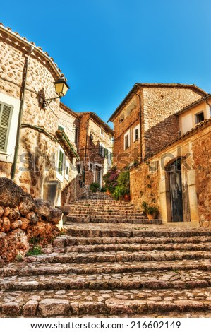 Sloping lane in the village of Fornalutx, Mallorca, Balearic Islands, Spain - stock photo