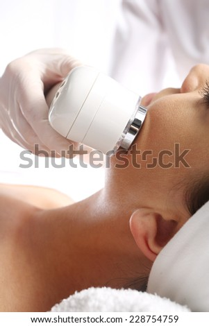Sloping oval of the face  Ultrasound beauty treatment,The woman's face during a facial at a beauty salon  - stock photo