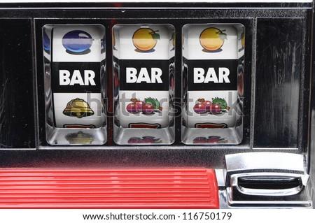 Slot machine and jackpot three bars on light background - stock photo