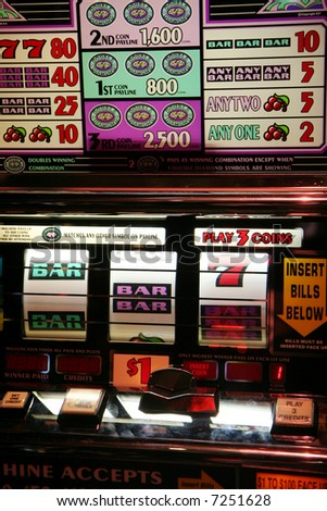 Slot machine in a casino ready to be played - stock photo