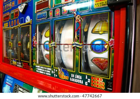 Slot machine in a spanish bar - stock photo