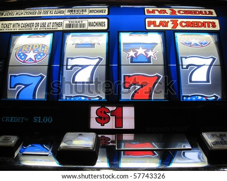 slot machine symbols which eventually paid off in quarters - stock photo