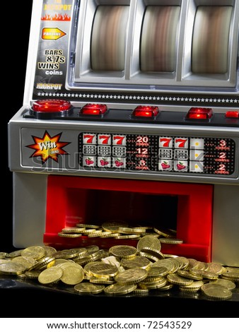 Slot Machine with a lot of coins - stock photo