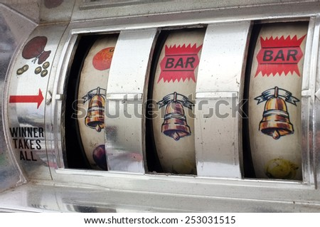 Slot machine with three bells jackpot - stock photo
