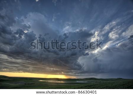 Slough pond and crop Saskatchewan Canada - stock photo