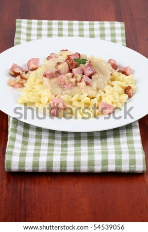 "Slovak national food called ""halusky"" - small potato dumplings (gnocchi) with sauerkraut and smoked meat - stock photo"