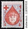 SLOVAKIA - CIRCA 1993: A stamp printed in Slovakia shows a portrait of a girl in a drop of blood, circa 1993 - stock photo