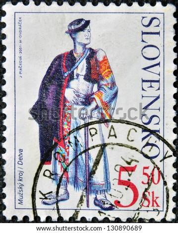 SLOVAKIA - CIRCA 2001: A stamp printed in Slovakia shows male costume Detva, circa 2001 - stock photo