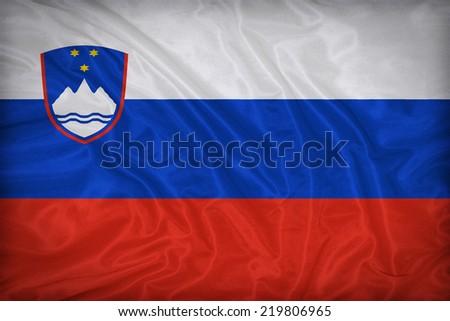 Slovenia flag pattern on the fabric texture ,vintage style - stock photo
