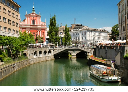 Slovenia Ljubljana Tromostovje Ljublianica river Church - stock photo