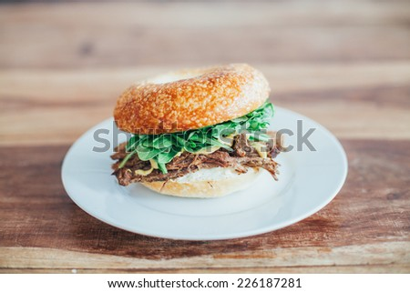 Slow-beef, Rocket, Mustard, Pickles, Cream Cheese Bagel - stock photo