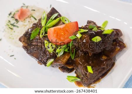 Slow-cooked beef ribs rubbed with Hawaiian salt seasoning - stock photo