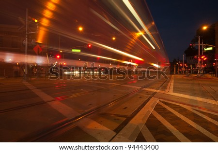 Slow exposure of a train during evening traffic - South Pasadena, California. - stock photo