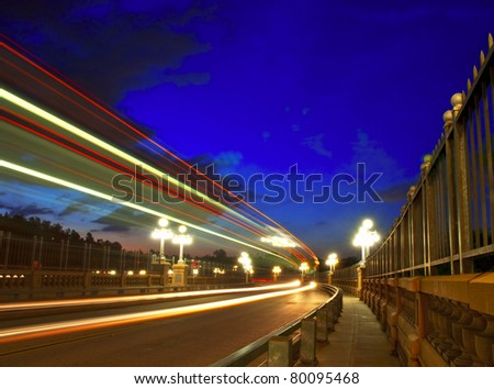 Slow exposure traffic view of the Colorado Street Bridge in Pasadena, California under a beautiful blue hour. - stock photo