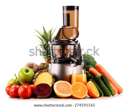 Slow juicer with organic fruits and vegetables isolated on white. Detox diet - stock photo