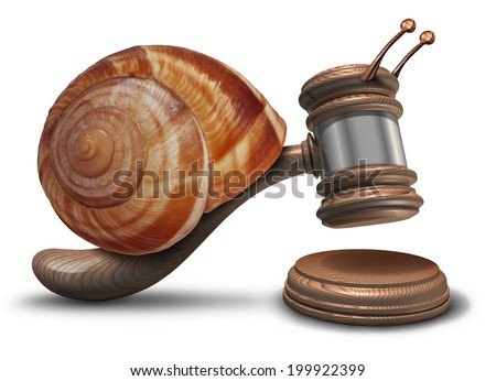 Slow justice law concept as a gavel or mallet shaped as a sluggish snail shell hitting a sounding block as a symbol of problems with legal system sentencing delays and lagging political legislation. - stock photo