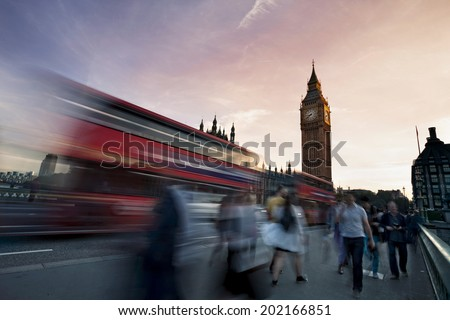 Slow motion blurred tourists and and traffic on Westminster Bridge with Big Ben in background, London. - stock photo