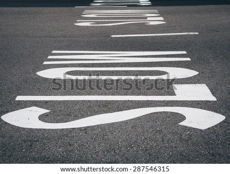Slow sign on street - stock photo