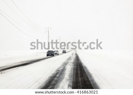 Slow traffic on snow storm on national road, romania - stock photo