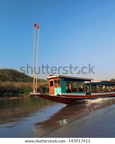 slowboat on Mekong river in Lao - tourists travelling from northern Thailand Chiang Khong  to Pak Beng and Luang Prabang - stock photo