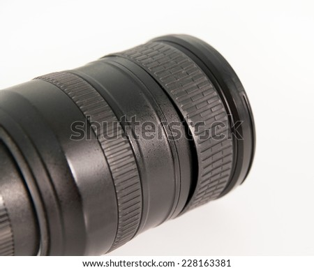SLR photography lens with loose rubber which is a common problem that needs fixing or replacing on a white isolated background - stock photo